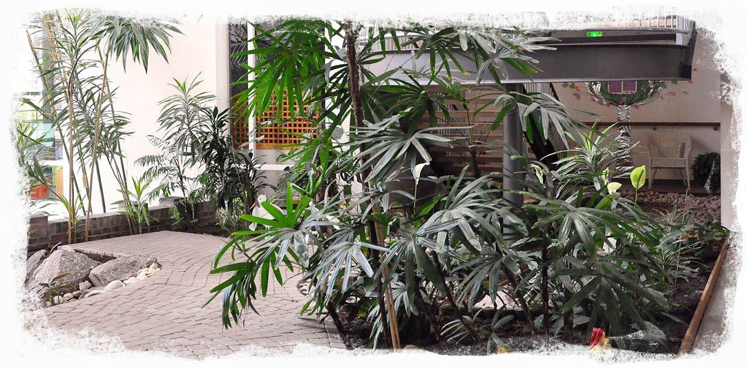 Le hall d'entrée verdoyant